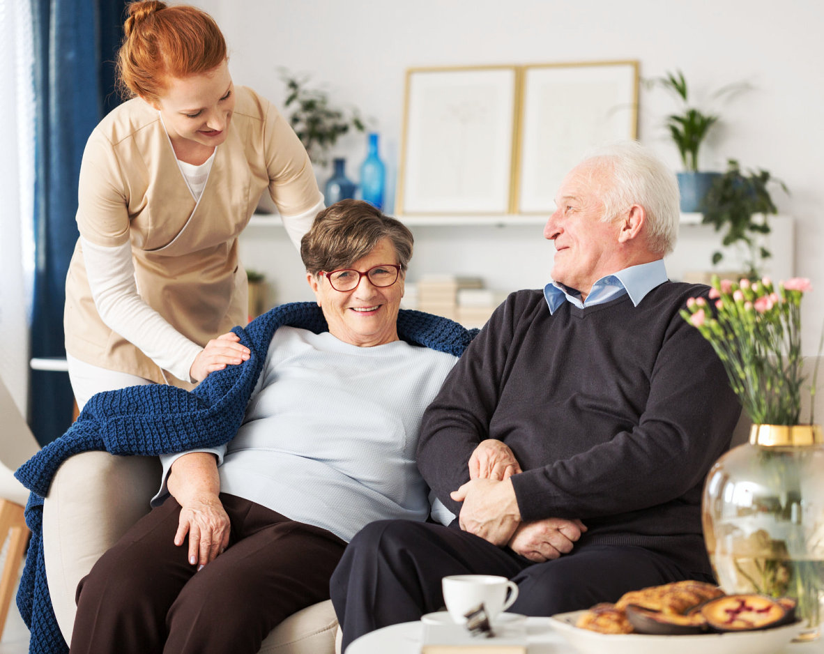 caregiver taking care of senior man and woman