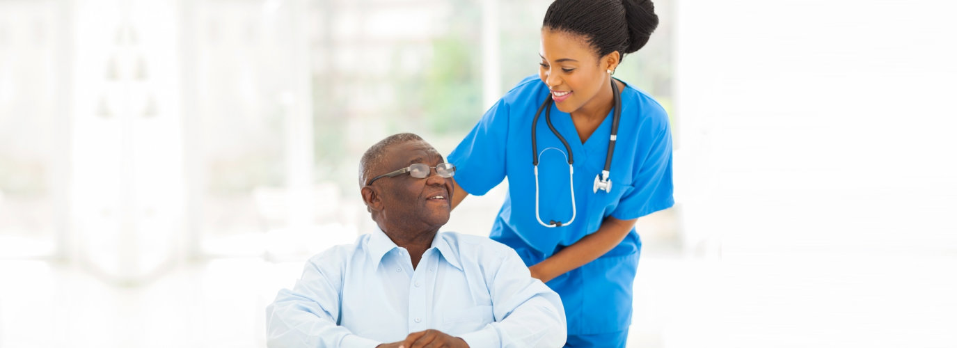 nurse smiling at senior man