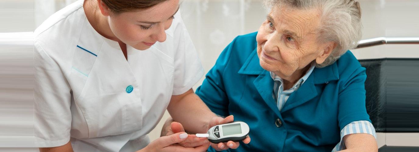 woman getting sugar level on senior woman
